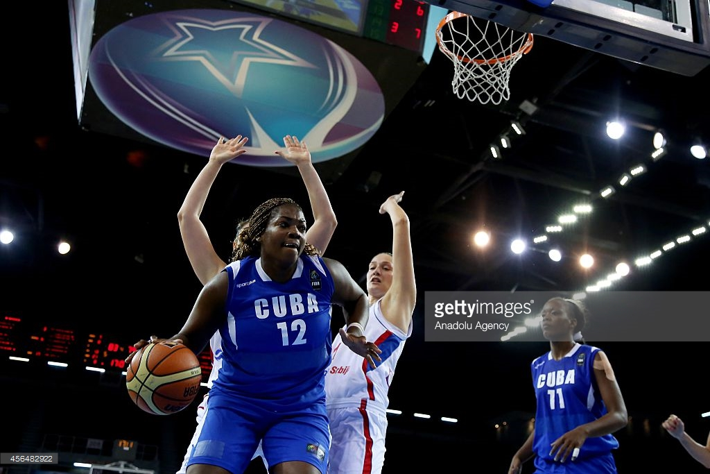 ISTANBUL, TURKEY - OCTOBER 1:  Clenia Noblet (12) of Cuba vies with her rival during 2014 FIBA World Championship For Women an elimination playoff match between Serbia and Cuba at Abdi Ipekci Sports Hall, in Istanbul, Turkey on October 1, 2014. (Photo by Ahmet Bolat/Anadolu Agency/Getty Images)